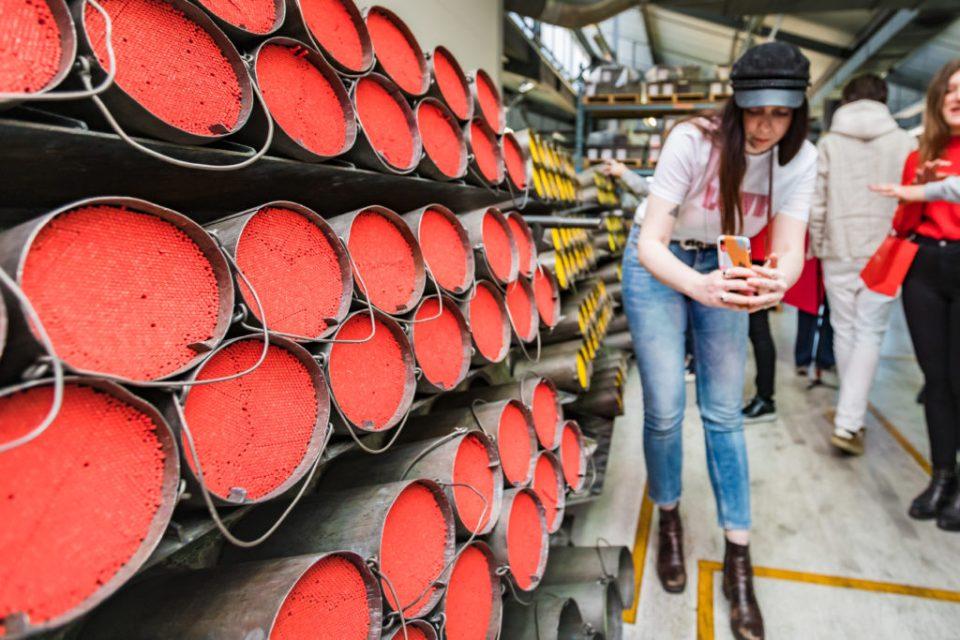 Emma Jane Palin shooting coloured pencils at caran d'ache factory