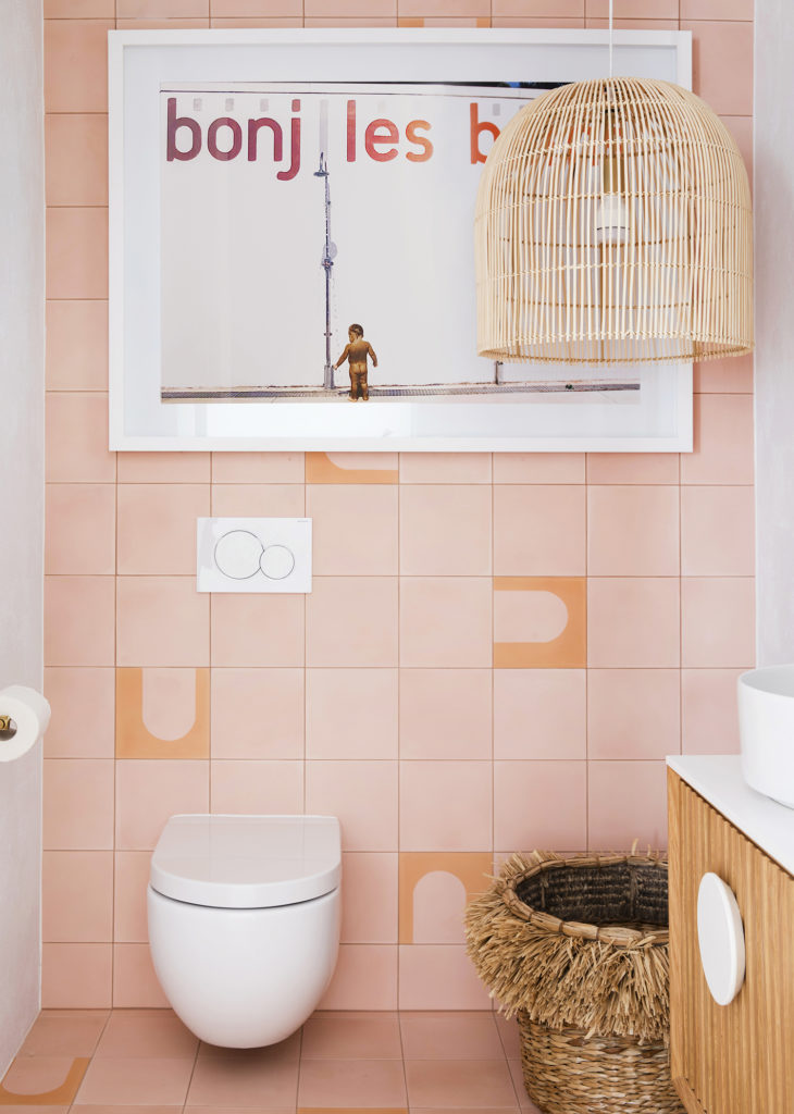 pink tiles with coral geometric pattern and boho accessories