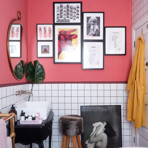 moroccan pink bathroom with white tiles and vintage dresser