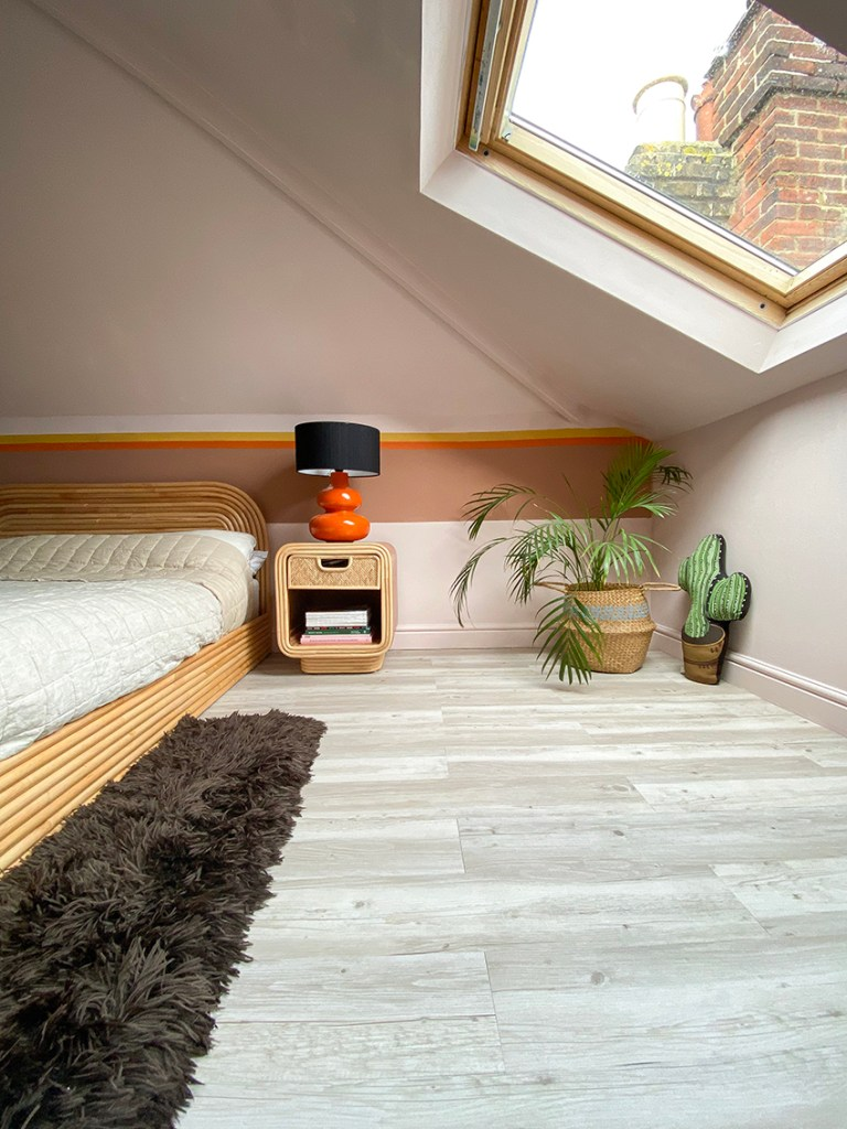70s style master bedroom with self-adhesive wooden flooring