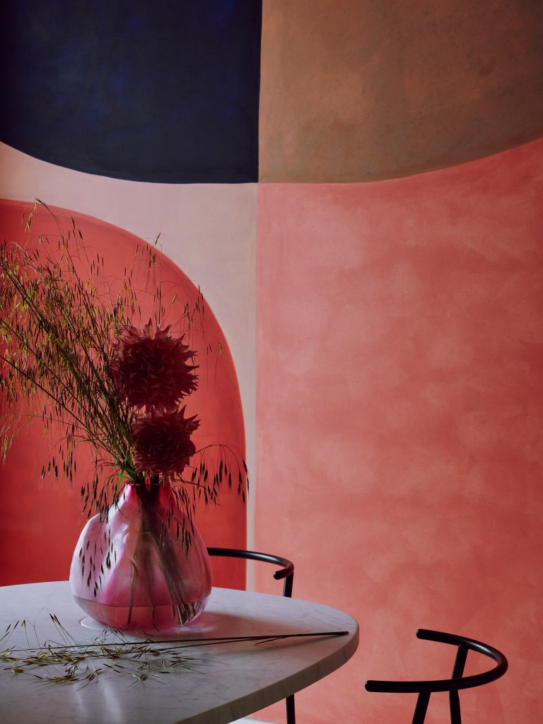 abstract mural with flowers in ceramic vase