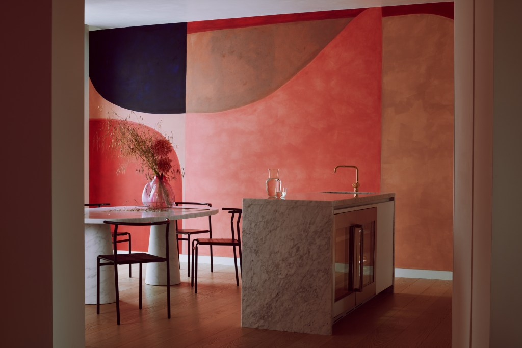 contemporary kitchen with abstract mural on wall