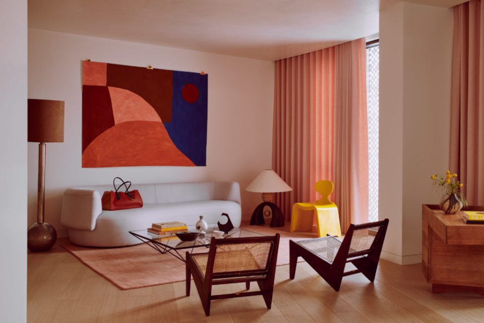 pink living room with abstract art