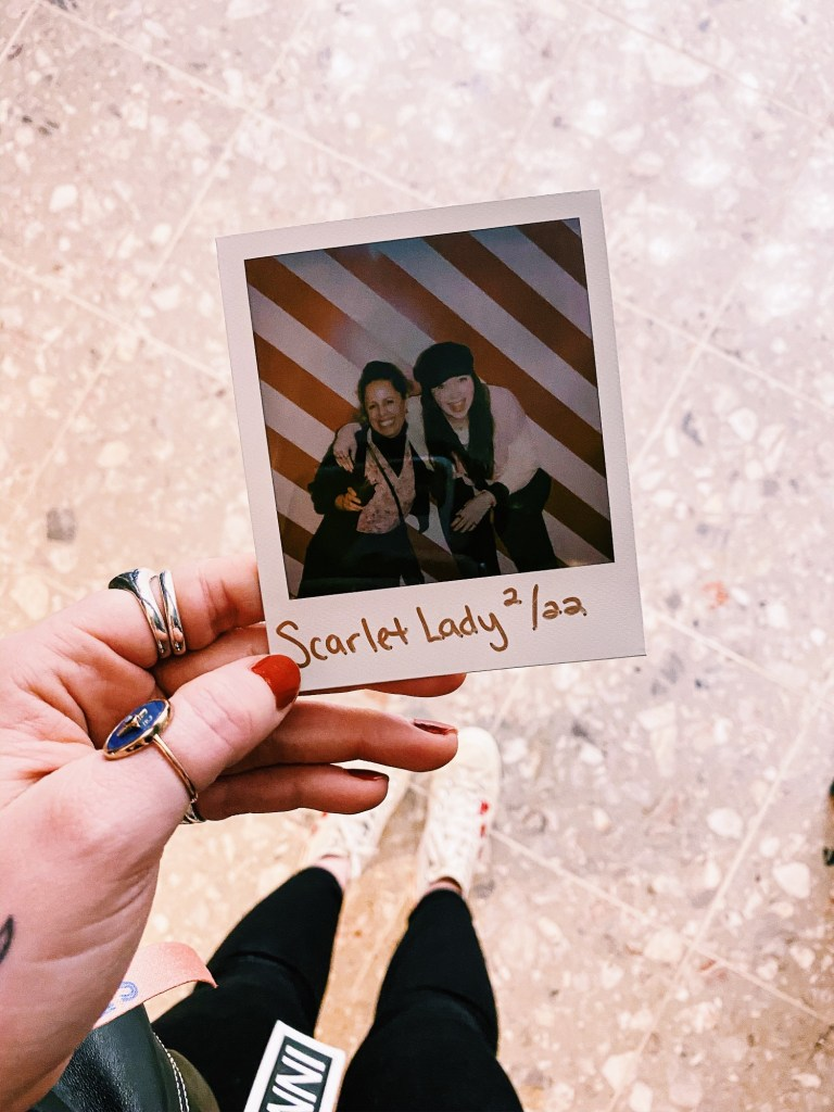 Polaroid photo of two girls on Virgin Voyages ship