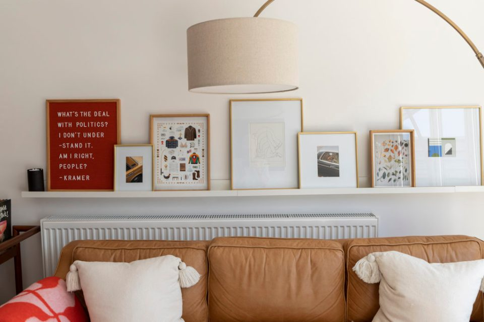 light living room with picture shelf