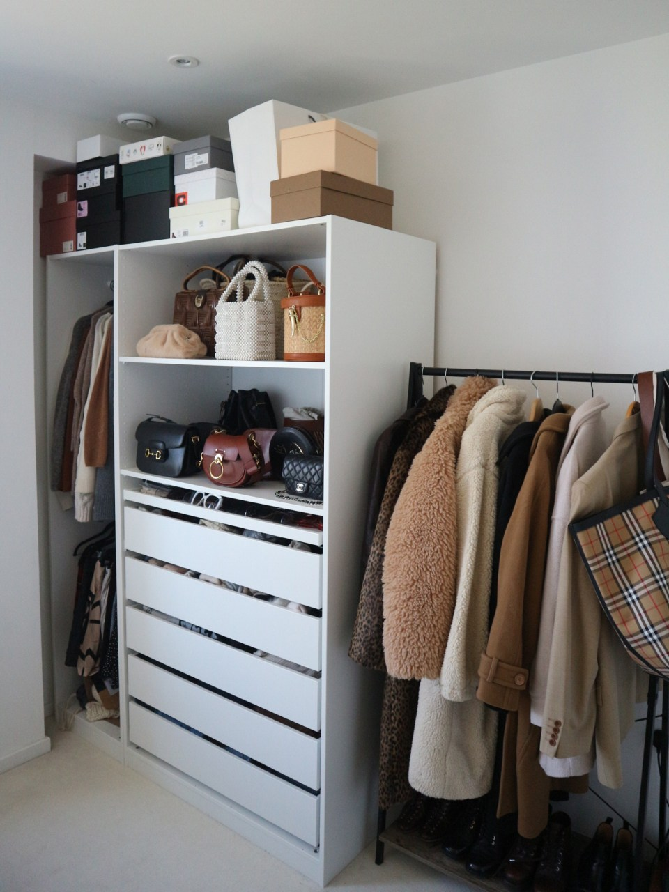pax wardrobe with bags and clothing rail