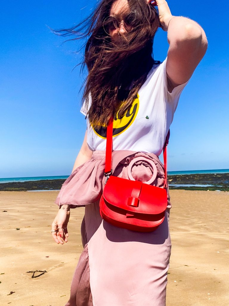 red and pink hoopla! bag on beach