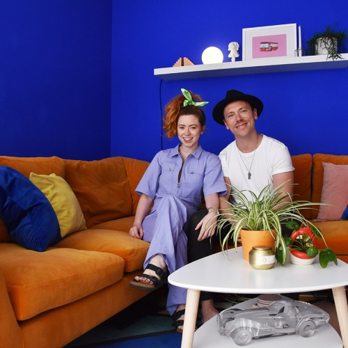 couple in yellow and blue living room