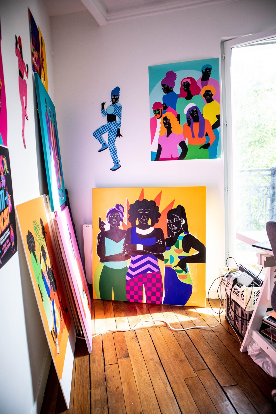 colourful prints and posters on white walls