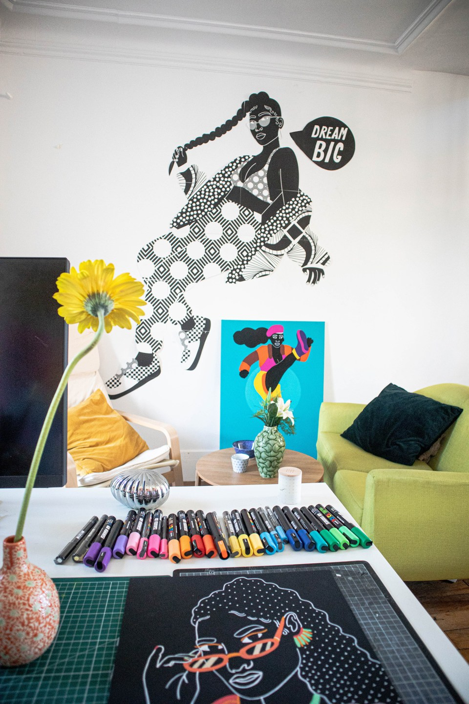 desk with post pens looking on to dream big mural