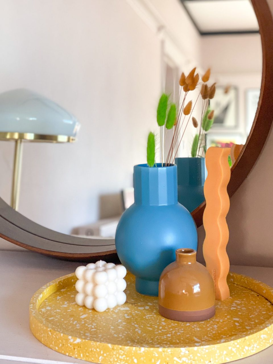 IKEA vase and sculptural candles on yellow terrazzo tray