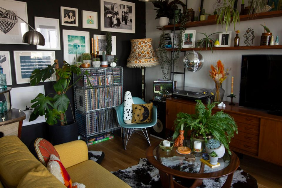 maximalist mid-century living room with navy walls