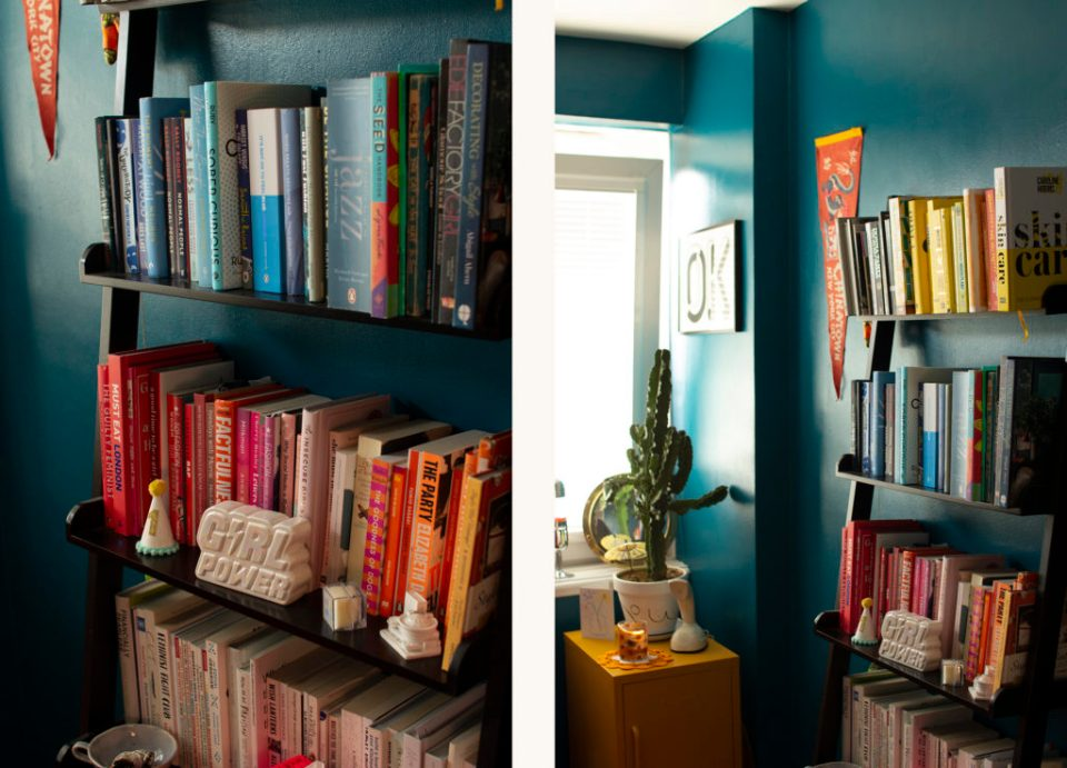 bright teal office meets guest bedroom with colour coordinated books