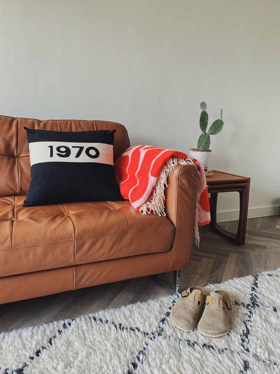 neutral living room with brown leather sofa