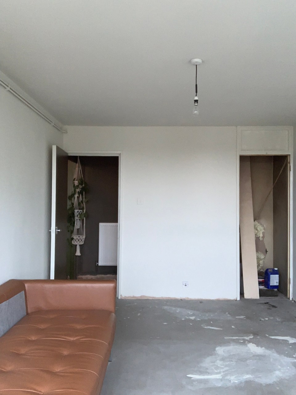 living room before renovation with concrete floors