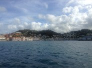 St. George's in Grenada. Here we saw men playing kitchen implements, selling conch shells, and preaching. A lot.