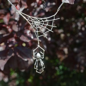 Sterling silver Orb Web Spider Necklace, the spider is hanging from its web