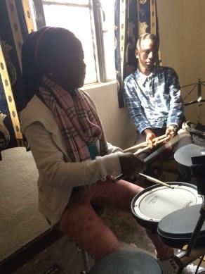 Leontine teaching new rhythms on the electric drum set