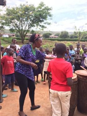 Faraha teaching students in Rwinkwavu
