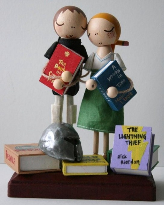 whimsical cake topper for bookworms