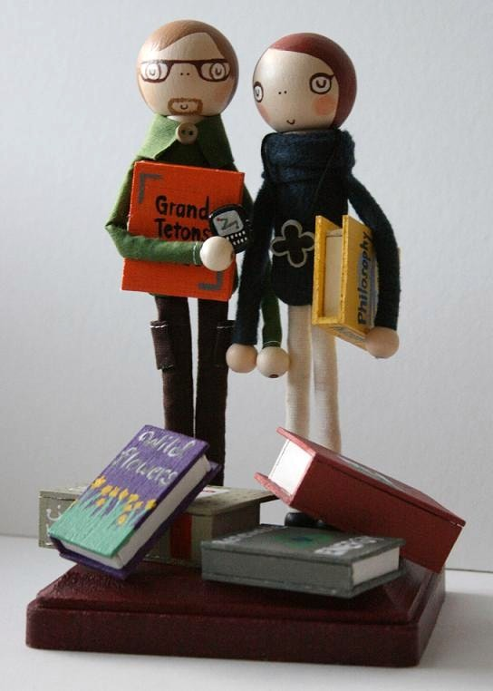 whimsical cake topper with books