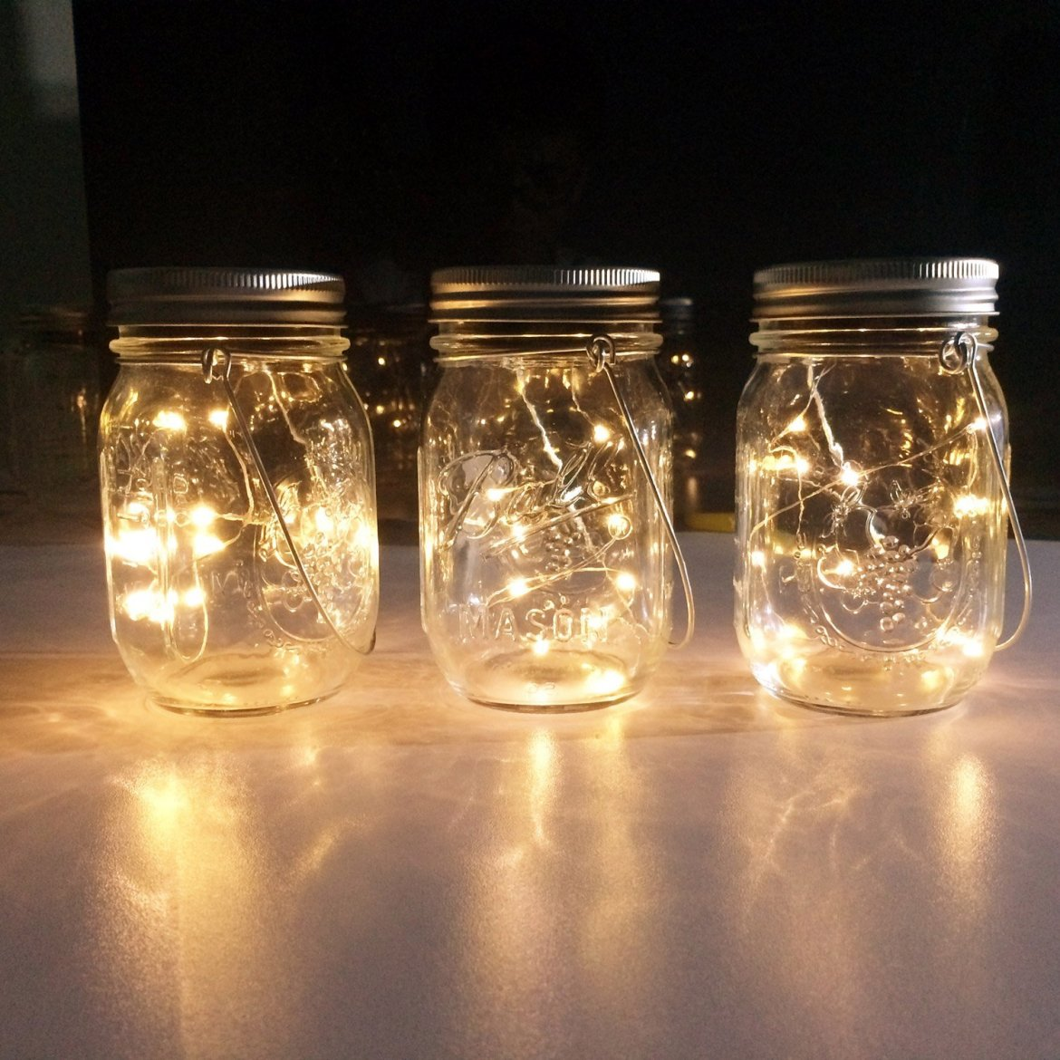 mason jar centerpieces diy idea with led fairy lights | http://amzn.to/2pACLkx