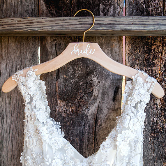 Bride wood dress hanger by Deighan Design | via Wood Themed Wedding Ideas: http://emmalinebride.com/themes/wood-themed-wedding-ideas/