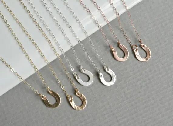 tiny horseshoe necklaces by silverlotusdesigns | barn reception ideas for weddings via http://emmalinebride.com/reception/barn-ideas-weddings/ 
