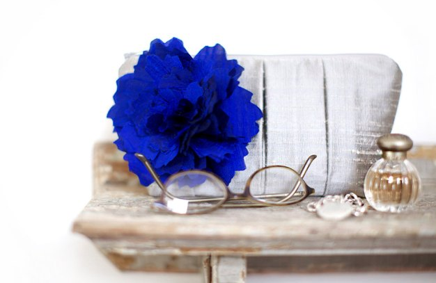 bridesmaid clutch with blue flower