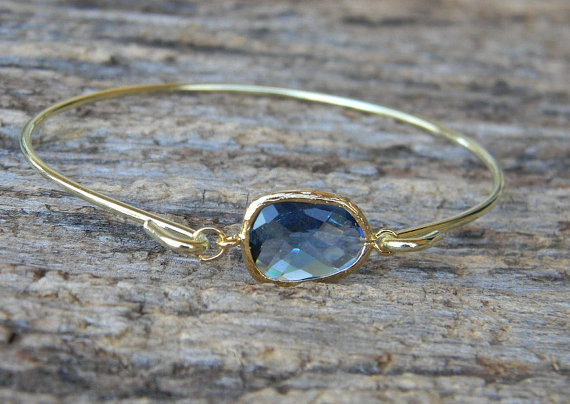 gold bracelet with navy stone by Greenperidot