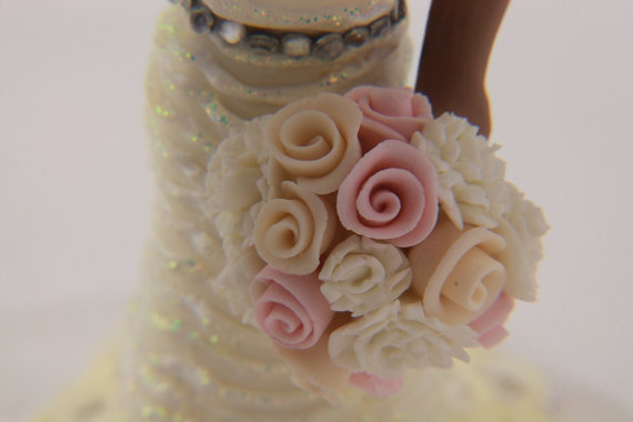 groom kisses bride on cheeck cake topper - gallery