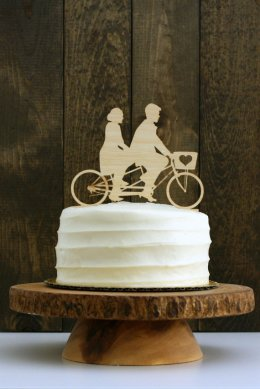silhouette cake topper on bicycle