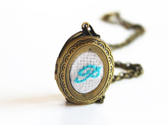 aqua embroidered locket