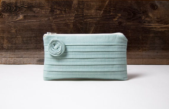 blue green clutch with rosette