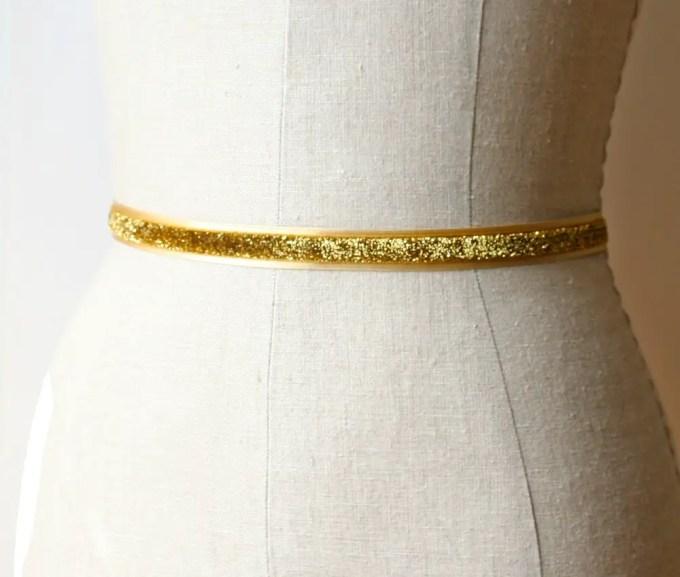Glittery gold dress sash | by Laura Stark | sashes dress | http://emmalinebride.com/bride/bridal-sashes-dress