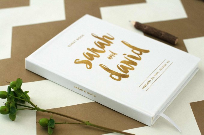 gold and white guest book side view