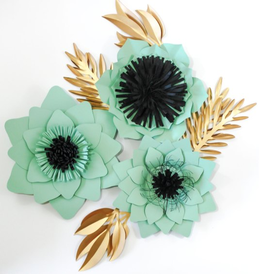 paper flower backdrop in mint and gold