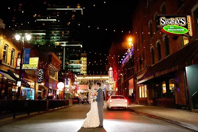 Detroit_wedding_bride_groom_monroe_street Downtown Detroit Wedding - http://emmalinebride.com/real-weddings/a-beautiful-downtown-detroit-wedding-nick-jeannine/ | Michigan wedding photographer - The Camera Chick
