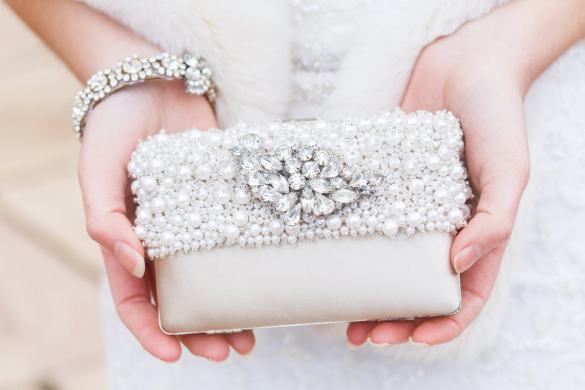 bridal clutch - via 7 Things You MUST Pack in Your Wedding Bag