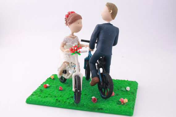 figurine cake toppers riding bikes