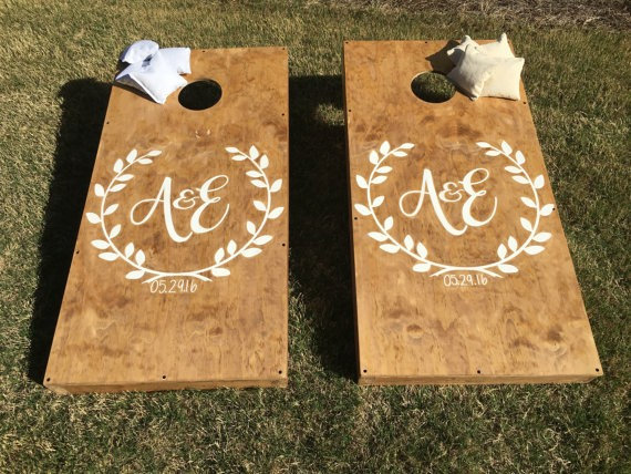 custom wedding cornhole boards by StarsStripesSawdust via 26 Things Guests Love at Weddings from A to Z   http://emmalinebride.com/planning/things-guests-love-at-weddings/