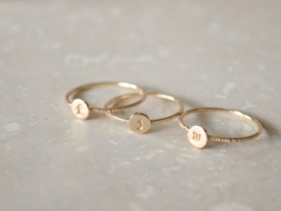 Stacking initial rings by FruitionLA | via http://emmalinebride.com/wedding/stacking-initial-rings/