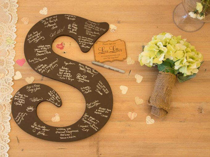 Monogram Guest Book - 100 Ways to Save Money on Your Wedding | via Emmaline Bride | http://bit.ly/2dtrgoW