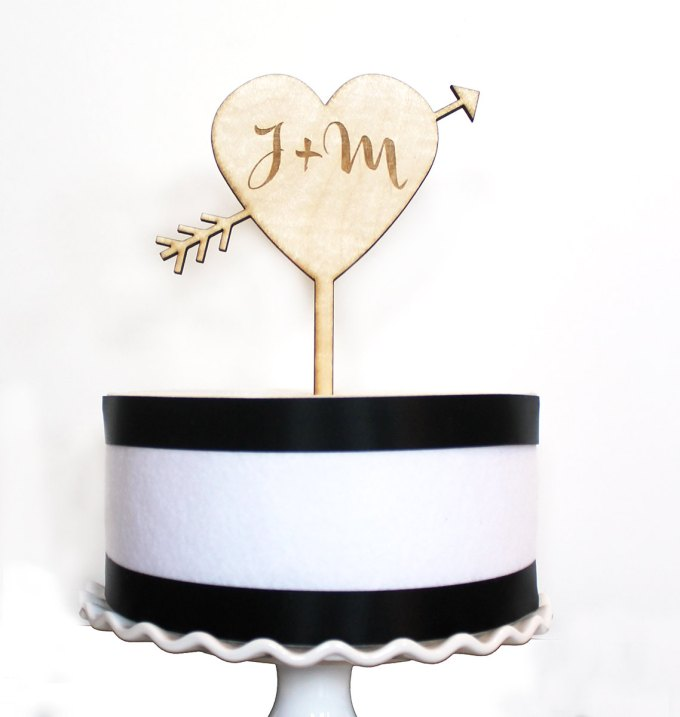 heart and arrow cake topper | via Heart and Arrow Wedding Ideas: http://emmalinebride.com/themes/heart-and-arrow-wedding-ideas