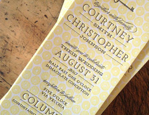 yellow letterpress invitation