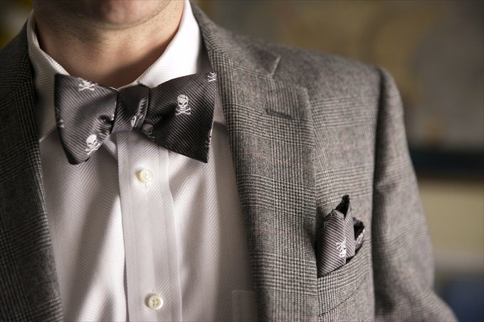 grooms skull and crossbones bow tie in this Crystal Coast Wedding | North Carolina wedding photographed by Ellen LeRoy Photography - http://emmalinebride.com/real-weddings/breathtaking-crystal-coast-wedding-mara-will-married/