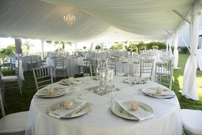 outdoor wedding reception tent in this Crystal Coast Wedding | North Carolina wedding photographed by Ellen LeRoy Photography - http://emmalinebride.com/real-weddings/breathtaking-crystal-coast-wedding-mara-will-married/