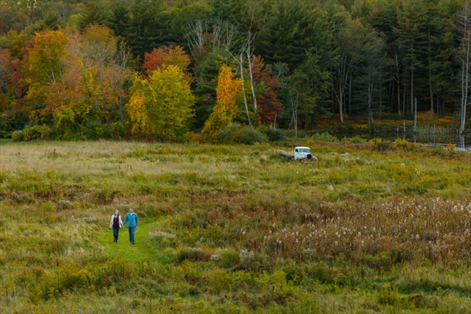 couple walks through field during fall engagement session| engagement photography by Butler Photography LLC.| Love Fall Weddings? See this Somers, CT Engagement Session - http://emmalinebride.com/real-weddings/love-the-fall-weddings-see-this-somers-ct-engagement-session/