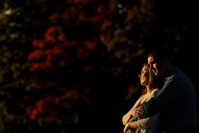 engaged couple embrace under sunset during engagement session| engagement photography by Butler Photography LLC.| Love Fall Weddings? See this Somers, CT Engagement Session - http://emmalinebride.com/real-weddings/love-the-fall-weddings-see-this-somers-ct-engagement-session/