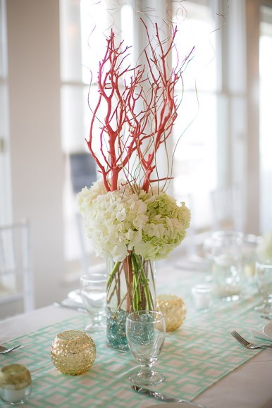 Beach Wedding Centerpieces with Flowers and Coral - Bald Head Island Wedding - Photo by Eric Boneske